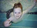 boy underwater bubbles